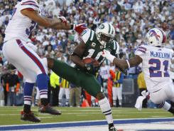 New York Jets' Santonio Holmes catches a TD pass against the Buffalo Bills Sunday.