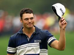 Martin Kaymer of Germany waves to the gallery on the 18th green during the final round of the WGC-HSBC Champions.