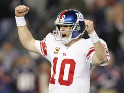 Giants quarterback Eli Manning led a late comeback against the Patriots.