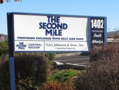 A sign for The Second Mile charity is seen outside the organization's headquarters in State College, Pa., on Nov. 2. The charity's founder, former Penn State assistant football coach Jerry Sandusky, was charged Saturday with 40 criminal counts for allegedly molesting eight boys.