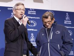 Penn State athletic director Tim Curley, left, with Nittany Lions football coach Joe Paterno last month.