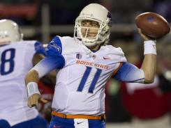 Kellen Moore passes during Saturday's win against UNLV, his 46th victory as Boise State quarterback, a Football Bowl Subdivision record. The Broncos are 8-0 and face TCU this week.