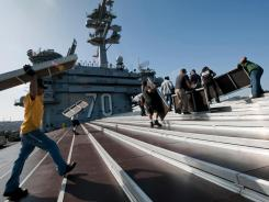 The use of the deck of the USS Carl Vinson, the ship that took Osama bin Laden's body to sea, for a high-profile college basketball game Friday is troubling to some Islamic scholars.