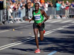 Geoffrey Mutai, of Kenya, runs through Central Park on his way to winning the ING New York City Marathon on Sunday.