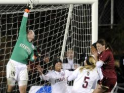 Stanford goalie Emily Oliver, making a save in last year's semifinals vs.  Boston College, boasts a 0.25 goals-against average this year.