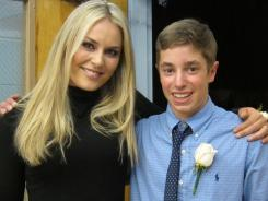 In this Nov. 4 photo provided by the U.S. Ski Team, Lindsey Vonn stands with her date, Parker McDonald, after the 16-year-old student escorted the Olympic gold medalist to his homecoming dance in Vail, Colo.