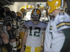 Green Bay Packers quarterback Aaron Rodgers waits to come onto the field before their game against the San Diego Chargers.