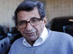 Penn State football coach Joe Paterno leaves the Louis and Mildred Lasch Football Building on the school campus in State College, Pa., on Tuesday.