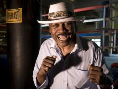 Joe Frazier spent much of his retirement  from boxing training kids in his gym in Philadelphia.