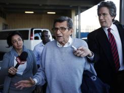 Penn State football coach Joe Paterno leaves the Louis and Mildred Lasch Football Building on the Penn State campus in State College, Pa., on Tuesday.