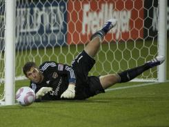 Houston Dynamo goalkeeper Tally Hall saves a shot on goal in the second half during a game against the Portland Timbers at Jeld-Wen Field on Oct. 14. The Dynamo beat the Timbers 2-0.