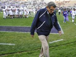 Penn State coach Joe Paterno walks off the field after warmups before his team played Northwestern last month.