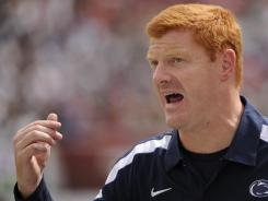 Penn State Nittany Lions wide receiver coach Mike McQueary is the once unnamed graduate assistant who identified former coach Jerry Sandusky with a young male at the school's  in 2002.