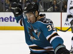 Logan Couture's third-period goal sealed the Sharks' seventh win in their last nine games.