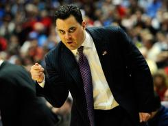 Head coach Sean Miller of the Arizona Wildcats gestures from the sidelines against the Duke Blue Devils during the west regional semifinal of the 2011 NCAA men's basketball tournament at the Honda Center on March 24, 2011.