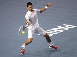 Novak Djokovic of Serbia raps a forehand during his victory Wednesday against Ivan Dodig of Croatia.