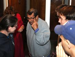Joe Paterno, center, talks to Penn State students outside his home in State College, Pa. as his wife, wearing red on the left, looks on. Paterno was fired as head football coach on Wednesday night.