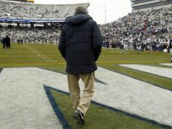 Joe Paterno leaves coaching with 409 career victories, but also  with unresolved questions about his role in the abuse scandal involving former assistant Jerry Sandusky.