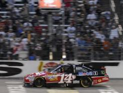 Tony Stewart crosses the finish line at Texas Motor Speedway, where his fourth win of the 10-race championship run still doesn't have him in the points lead.