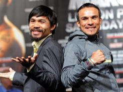 Manny Pacquiao, left, and Juan Manuel Marquez have fought twice. Pacquiao won once, and the other bout ended in a draw.