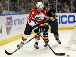 Kris Versteeg (32), battling with Sabres defenseman Tyler Myers, has been part of the Panthers' strong start this season.