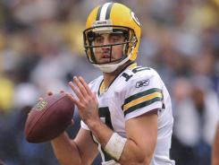 Packers quarterback Aaron Rodgers, who passed for 247 yards and four touchdowns on Sunday, is on pace for over 5200 yards and 48 TDs with half of the regular season left to play.