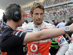 British Formula One driver Jenson Button, shown at the Grand Prix of India, is nursing a 13-point lead on Fernando Alonso for second place.