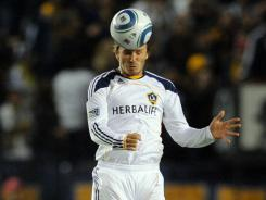 Los Angeles Galaxy midfielder David Beckham heads the ball against Real Salt Lake during the first half at the Home Depot Center on Nov. 6.