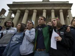 Penn State students gather at Old Main, at the center of the school's campus, to express solidarity with the alleged rape victims in the Jerry Sandusky case.
