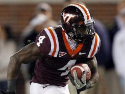 Virginia Tech running back David Wilson breaks into the flat against Georgia Tech on Thursday. Wilson rushed for a career-best 175 yards in the game.