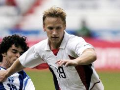 The United States' David Testo, right, fights for the ball against Honduras' Jeffrey Frazier Brooks during their Under-23 Olympic qualifying match in 2004. On Thursday, Testo announced that he was gay.