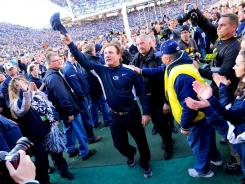 Penn State interim head coach Tom Bradley acknowledges the cheers after the game against Nebraska.