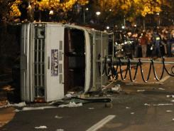 The actions of Penn State students following the firing of football coach Joe Paterno, including overturning this TV news van, prompted a University of Nebraska regent to inquire about security measures for Saturday's game.