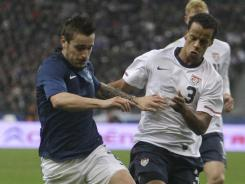 France's Mathieu Debuchy, left, challenges for the ball with the U.S.'s Timmy Chandler during their friendly match at Parc des Princes stadium in Saint Denis on Friday, France won 1-0.