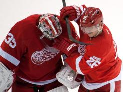Red Wings goalie Jimmy Howard is congratulated by Jiri Hudler after defeating the Edmonton Oilers 3-0 at the Joe Louis Arena in Detroit. Howard tied his career high, posting his third shutout of the season.