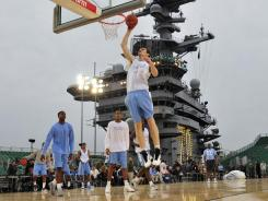 North Carolina's Tyler Zeller hits the hoop during practice on the USS Carl Vinson.