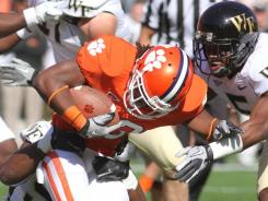 Clemson running back Andre Ellington (23) lowers his head on a first-half run in the Tigers' victory against Wake Forest.