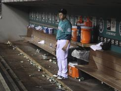 One Mariner yearning for better times, first baseman Justin Smoak, remains in the dugout after a September loss to the Yankees. The 2011 Mariners lost 95 games.
