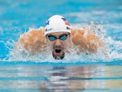 Michael Phelps completed a 4-for-4 weekend at the Minneapolis Grad Prix, winning the 200-meter butterfly and the 100 backstroke.