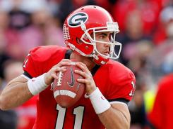Georgia quarterback Aaron Murray hrew four touchdown passes to surpass Matthew Stafford's school record.