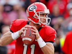 Georgia quarterback Aaron Murray hrew four touchdown passes to surpass Matthew Stafford's school record.