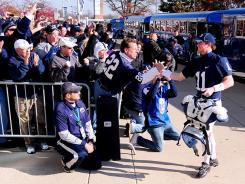 Fans greet Penn State quarterback Matt McGloin (11) Saturday before the game against Nebraska.