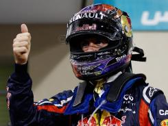 Sebastian Vettel celebrates after qualifying first for Sunday's Abu Dhabi Formula One Grand Prix in the United Arab Emirates.