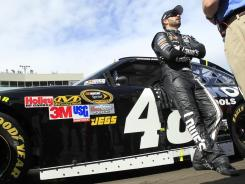 Jimmie Johnson, standing before his No. 48 Chevrolet prior to Sunday's race at Phoenix, left the track knowing he cannot win a sixth consecutive series title.