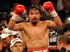 Manny Pacquiao retains WBO welterweight title with controversial points ...