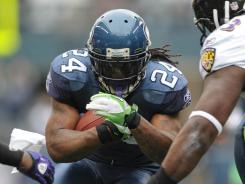 Marshawn Lynch rushed for 109 yards and a touchdown as the Seahawks stunned the Ravens.