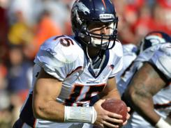 Point man:  Broncos quarterback Tim Tebow, poised to pitch the ball Sunday, completed two passes vs. the Chiefs but ran and passed for touchdowns.