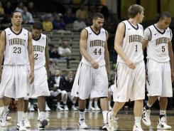 Vanderbilt players walk off the court following their loss to Cleveland State on  Sunday.