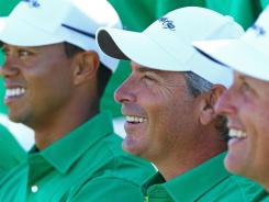 Captain Fred Couples, flanked by Tiger Woods and Phil Mickelson, was on the U.S. team that lost in 1998  in Australia.