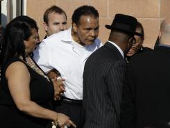 Former boxing champion Muhammad Ali leaves after a memorial service for boxing legend Joe Frazier at the Enon Tabernacle Baptist Church in Philadelphia.